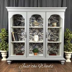 Repurpose the top of a china cabinet by adding feet and turn it into a modern chic curio cabinet. With a fabric decoupage back this painted furniture makeover is a DIY project for everyone