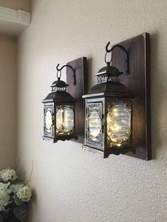 How pretty are these farmhouse style hanging lantern wall sconces with fairy tale LED lights?! They would look cute indoors or outdoors. |  promotion | farmhouse lighting ideas |