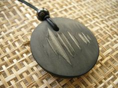 mangetsu Bamboo Charcoal Pendant from the Charcoal People. mangetsu means full moon. A pleasingly round shape that gives a feeling of wholeness. When you feel like wearing something large-ish, this may be ideal - not heavy at all, though. And nice to touch as well. 3.8cm. Visit www.charcoalpeople.co.uk/buy_pendants.htm to purchase.