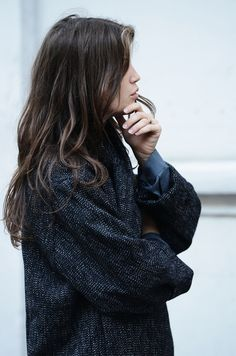 brunette and oversized sweater