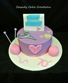 A knitting and card making themed 70th birthday cake
