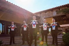 Unique wedding groom idea - groom + groomsmen wore superhero shirts under their suits! {Candid Moments Photography}