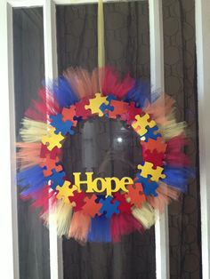 Autism Puzzle wreath, made by my talented sister. Shop here: http://www.etsy.com/listing/160048200/autism-puzzle-wreath