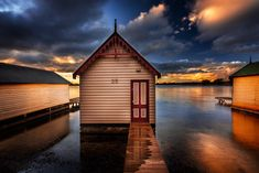 Visit www.AleksTrpkovski.com for more details - Have you ever been to Lake Wendouree in Ballarat? Even though most of the people go to Ballarat to the iconic Sovereign Hill, Lake Wendouree is another lovely place worth visiting when you are in the area. I went there last Friday and as I came across to these boat sheds this particular once capture my attention. I decided to wait until sunset when the light gets better to photograph it.  I hope you like it! Boat Shed, Places Worth Visiting, Camera Settings, Google Images, Sheds, House Styles, Photograph, Friday, Sunset