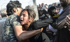 Syrian refugees cross into Turkey - in pictures