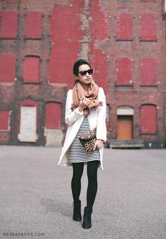 Striped dress, black tights, black booties, white coat,camel scarf, black sunglasses, ponytail