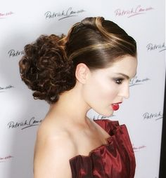 A long brown curly straight top knot glamourous wedding classic hairstyle by Patrick Cameron