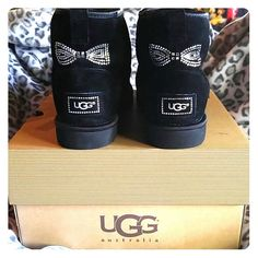 Black UGG boots w/bling bows Beautiful never worn... Short style UGG boots with sparkle bows. Purchased brand new from Nordstrom...comes with UGG box (not original box). ***no trades*** UGG Shoes Ankle Boots & Booties