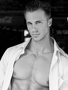 Bare chested hunk with white dress shirt
