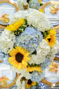 Blue and White Hydrangeas on Tablescape with Yellow Sunflowers for fall entertaining