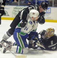 Tina Russell / Observer-Dispatch From left, San Antonio player Stephan Vigier hits Utica Comets player Brandon DeFazio in the face during AHL hockey at the Utica Memorial Auditorium Thursday, Jan. 1, 2015. Read more: http://www.uticaod.com/apps/pbcs.dll/gallery?Site=NY&Date=20150101&Category=PHOTOGALLERY&ArtNo=101009998&Ref=PH&taxoid=&refresh=true#ixzz3NdfUDmn8
