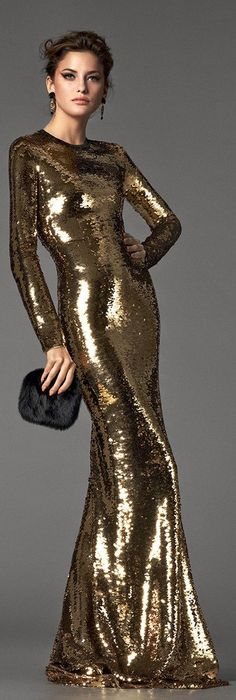 [Very slinky!  It almost looks painted on.] Stunning golden dress by Tom Ford.