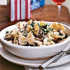 Farfalle with Creamy Wild Mushroom Sauce Recipe Main Dishes with bow-tie pasta, butter, mushrooms, chopped onion, shallots, minced garlic, salt, ground black pepper, dry white wine, whipping cream, parmigiano-reggiano cheese, fresh parsley, fresh parsley