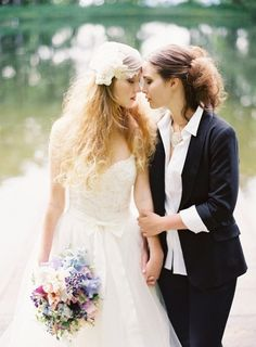 This is a beautiful portrait. The bride on the right looks feminine yet unique. It's perfect. #lesbian #wedding