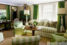 don't think my hubs would let me get away with THIS much green, but i do love that couch.