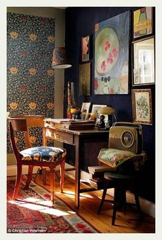 Love the play of light in this otherwise dark study space. All in all it is quite lovely. Check out the old radio...