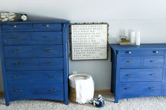 Go bold! Dark blue dressers with brass hardware.