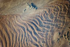 Linear Dunes Namib Sand Sea An astronaut aboard the International Space Station (ISS) used a long lens to document what crews have termed one of the most spectacular features of the planet: the dunes of the Namib Sand Sea.