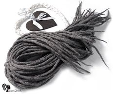 Wool dreadlocks  Quiet Wind  DE  Type: Double Ended Material: Worsted wool Method: Felted, handmade Pieces in set: Choose the quantity in the listing options Lenght: 30-40 inch (80-100cm) - 15-20inch (40-50cm) folded in half Thickness: 0.39-0.79 inch (1-2cm) Color: mix grey   Quantity: If you have a mohawk - 30 pieces will be enough If you have a thin hair - 40 pieces will be enough If you have a tchick hair - you need 50-60 pieces   Wool dreadlocks have many advantages:  * Light – does not…