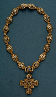Portuguese Necklace in gold filigree and enamel. Nineteenth century. #Portugal. Is a delicate kind of jewelry usualy of gold & silver made with tiny beads or twisted threads or both in combination & then soldered together or to the surface of an object. Found objects as old as in Phoenicians sites was perfected by Greeks & Etruscans