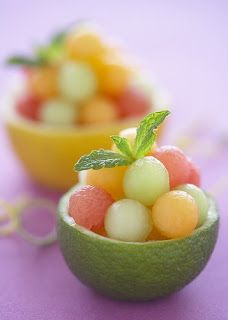 So colourful & refreshing ~ Lemons & limes scooped out & made into individual bowls & fill with balls of melon,peach & pear