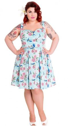 The rockabilly-inspired Lacy Mini Dress in Turquoise is a must-have in any pin up's closet this season! #blamebetty #floral #pinupdress