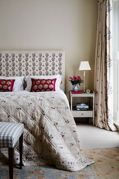 Printed fabrics abound in the main bedroom: the headboard, quilt and curtains are all from Chelsea Textiles
