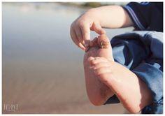 Beach baby portrait. Sandy toes.