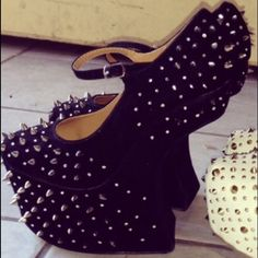 Black heel-less pumps Black spike heel-less, size: 7, never been worn. Love but never have the occasion to wear! Shoes Heels
