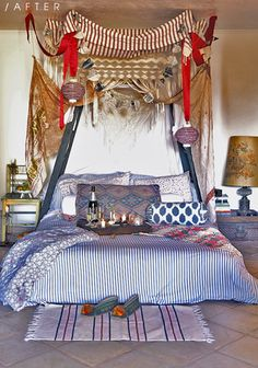 low-to-the ground bed, very bohemian, almost indian-inspired decor. love it.