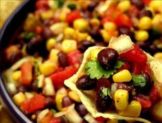 15 minute Black Bean and Corn Salsa - Rotel canned tomatoes, corn, black beans, onion, cilantro, and lime juice.