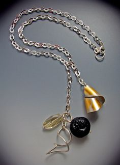 Charm necklace by Judith Neugebauer
