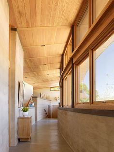 The rammed earth walls & concrete floors help regulate the temperature in this modern ranch home.