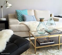 Vittsjo coffee table hack- I love the gold contrast against the florals and cream sofa!