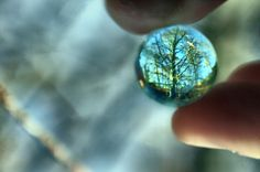 used a marble, but focused the picture so you can see through the marble and everything else is blurry
