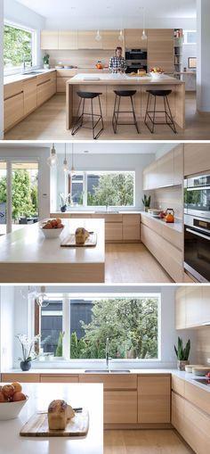 Tres vistas de una hermosa cocina moderna.