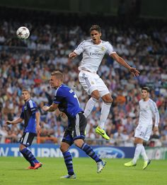 Raphaël Varane heads the ball beside Ragnar Sigurdsson during the UEFA Champions League group B match between Real Madrid CF and FC Copenhagen at Estadio Santiago Bernabéu on October 2, 2013 in Madrid, Spain.