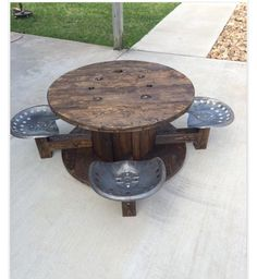 cable spool tables utility spools we used to create a patio set. We live in the country and everything blows away! Wooden Spool Tables, Cable Spool Tables, Wooden Cable Spools, Cable Reel Table, Pallet Furniture, Furniture Projects, Rustic Furniture, Wood Projects, Backyard Projects