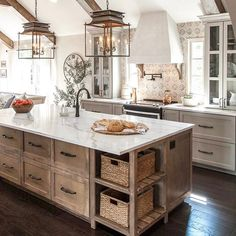 Beautiful rustic kitchen with lantern pendants. Via fixerupper