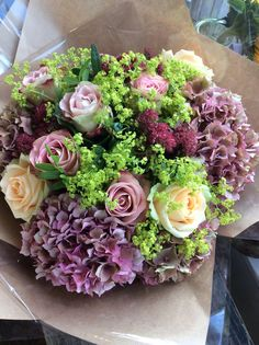 English hydrangea with a mix of roses and alchemilla made by Debbie