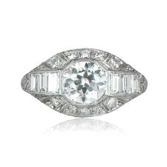 A beautiful Art Deco Era engagement ring, featuring a 1.08 carat old European cut diamond that is adorned by baguette-cut diamonds on either side, and set in a handcrafted platinum mounting. The center diamond is certified by the GIA as a 1.08 carats, H color and VS1 clarity. The GIA certificate is available upon request. Fine milgrain and openwork filigree adds to the delicacy of the ring.