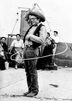 James Dean showing off his lasso skills on the set of Giant  