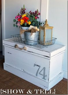 Hope chest, trunk, cedar chest, coffee table, storage, white, wire basket, galvanized pail, flowers, lantern