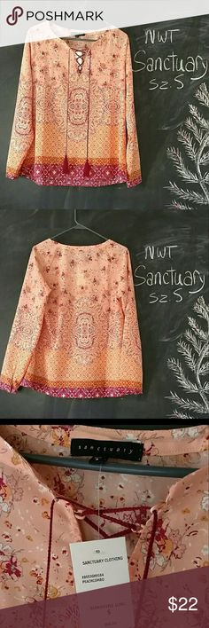 NWT Sanctuary Boho Peach Orange Top Shirt Sz S NWT Sanctuary Sz S boho style top.  Flowy with maroon tassels.    Sunshine Girl  Orange, peach, maroon colors.  Generous bust up to 38 in. Shirt Length is 24 in.   24 in length long sleeves. Polyester fabric.    Excellent condition.  Beautiful.  Brand New. No trades.  Smoke and Pet free environment. Sanctuary Tops