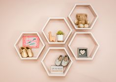 Unique wall shelves for a baby's room that you can fill with all of her special things