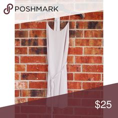 Light Cream T back Dress with Tie This is such a classic piece to have in a closet. It has a beautiful light cream color that's almost white. It comes with a slip underneath and a tie to show off your waist. Norah Dresses Mini
