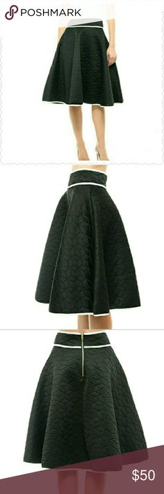 Midi Black & White Skirt Make a statement from desk to dinner in a midi silhouette, debuting abstract pattern. With zipper in the back. Style the look with a long-sleeve crop top for maximum sophisticated allure! Grab this for your business attire. Moon Collection Skirts Midi