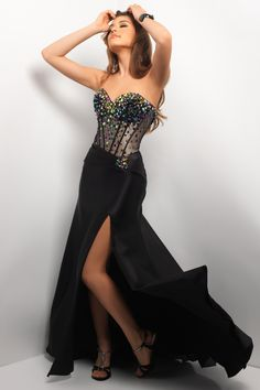 Formal prom dress with stunning illusion! Gorgeous jewels define the bust over a nude waist. A side-slit satin skirt creates pure drama.