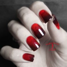 By Chan Fie. Black & red nails