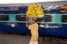 A man selling bananas at New Delhi Train Station, India